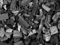 Background texture made of lumps of black charcoal